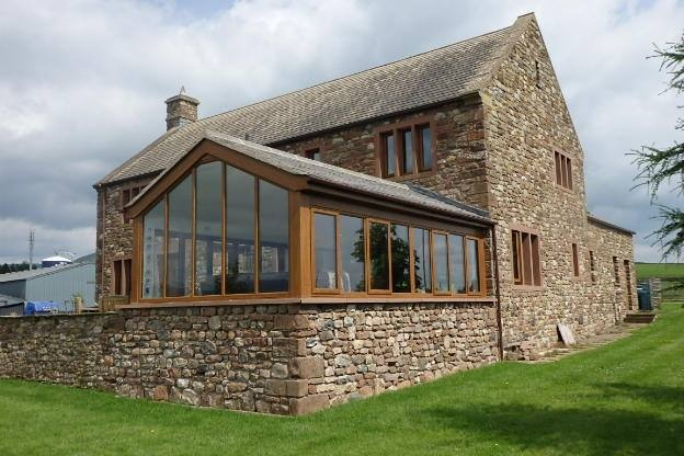 Oak PVC conservatory frames on traditional slate roof conservatory