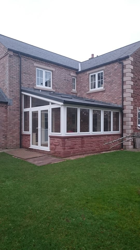 Warm Tiled Roof Conservatory with White PVC frames